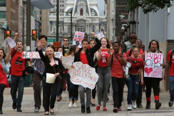 Philadelphia public high-school students march down Broad Street from City Hall to school district headquarters during a budget-cuts protest. (Emma Lee/for NewsWorks)