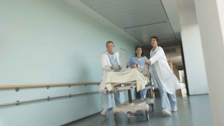 Hospital workers move a patient to surgery. (Image courtesy of <a href='http://www.shutterstock.com/pic.mhtml?id=145175149&src=p-146811386-2'>ShutterStock.com</a>)
