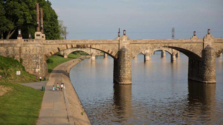 People walk along the Susquehanna River in Harrisburg, Pennsylvania. (Lindsay Lazarski/WHYY)