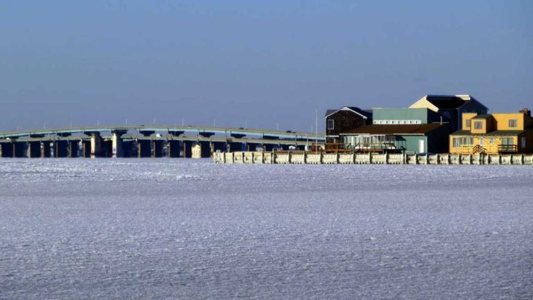 The frozen Barnegat Bay and the Mathis Bridge in the background as seen from Seaside Park on Jan. 7