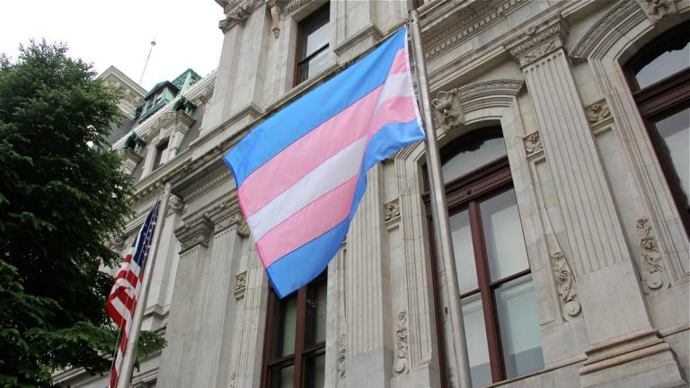 A flag representing transgender pride is shown flying at Philadelphia City Hall during the Trans Health Conference in June. (Emma Lee/WHYY, file)