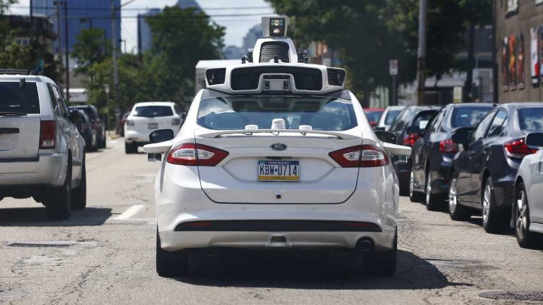 A self-driving Ford Fusion hybrid is test driven. (AP Photo/Jared Wickerham)
