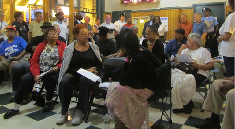Residents discuss community issues at a meeting inside the Queen Lane Station. (Aaron Moselle/WHYY, file)