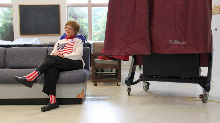 Election official Phyllis Detwiler waits for her next voter at the Collingswood Community Center in Nov 2013. (Emma Lee/for NewsWorks)