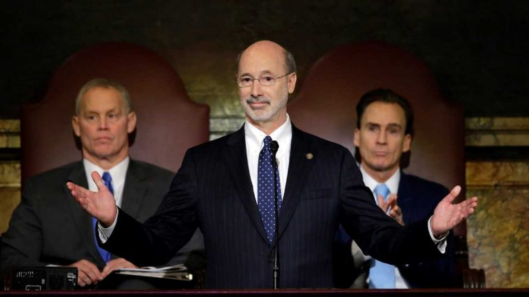 Pa. Gov. Tom Wolf is shown delivering his budget address for the 2015-16 fiscal year to a joint session of the state House and Senate in March. Behind him are the Speaker of the House of Representatives Mike Turzai, R-Allegheny, left, and Lt. Gov. Michael Stack, is at right. (Matt Rourke/AP Photo)