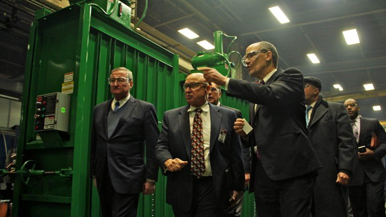 U.S. Secretary of Labor Thomas E. Perez (center) tours  PTR Baler & Compactor in Port Richmond with Philadelphia Mayor Jim Kenney (left) and other dignitaries. (Emma Lee/WHYY)