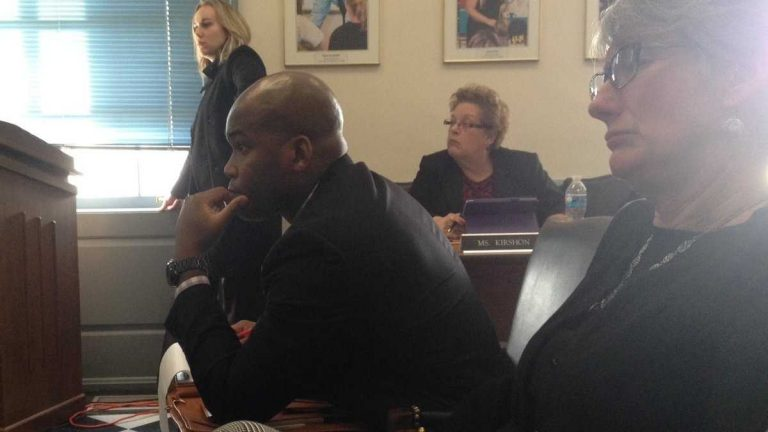 Dr. Lamont Browne (center) at a State Board of Education meeting. (Avi Wolfman-Arent, NewsWorks)