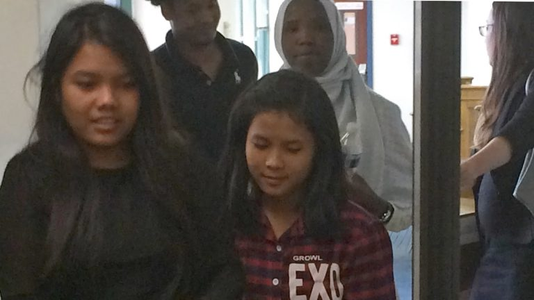 Sui Hnem Sung (left foreground), 19, and her sister Van Ni Iang, 17, leave federal court in Easton ahead of Qasin Hassan, 17,(left) and Khadidja Issa, 18. They're among six student refugees represented by a legal team including Education Law Center and American Civil Liberties Union attorneys in a lawsuit against the School District of Lancaster over enrollment, translation and other issues. (Emily Previti/WITF)