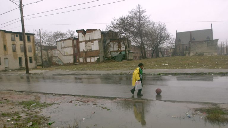 Michael Witherspoon walks home past abandoned rowhomes and empty lots in north Philadelphia. The 2010 census estimated that Pennsylvania has nearly 400,000 vacant properties, about 20,000 of which are in Pittsburgh and 40,000 in Philadelphia.  (AP File Photo/Dan Loh)