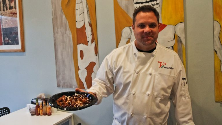 Nick Farina, owner of Union Taco at Seventh and Girard, will enter his sweet potato, apple chutney latke in the Latkepalooza at the Gershwin-Y Monday. (Kimberly Paynter/WHYY)