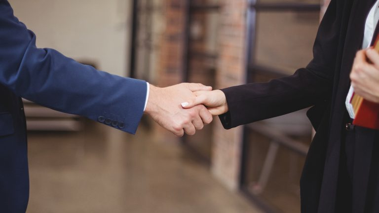 (<a href='http://www.bigstockphoto.com/image-123743294/stock-photo-midsection-of-female-lawyer-handshaking-with-client-while-standing-in-office'>Big Stock Photo</a>)