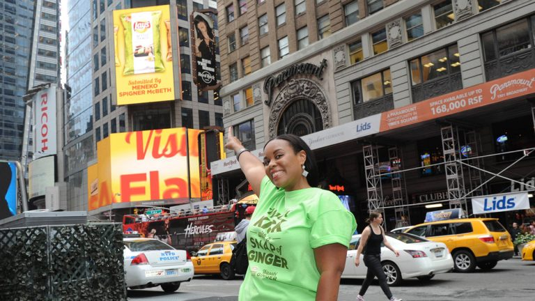 Meneko Spigner McBeth points to a billboard advertising her flavor in Lay's