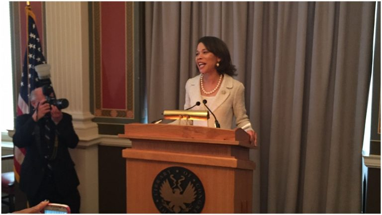 Rep. Lisa Blunt-Rochester speaking to supporters at a reception at the U.S. Capitol. (Paul Parmelee/WHYY)
