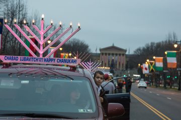 More than 250 cars gather on the Ben Franklin Parkway to parade through the city with lit electric menorahs atop their roofs in celebration of the third night of Hanukkah(Emily Cohen for NewsWorks)