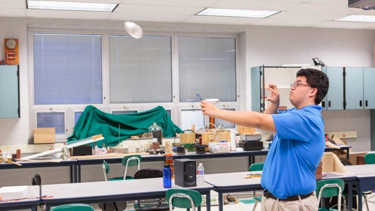 Physics team member Andrew Mangabat practices the 'Magnus Glider' challenge for IYPT 2015. (Jack Dugan/WHYY)