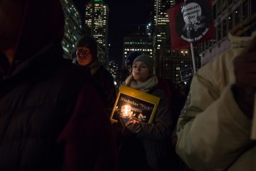 On the first day of winter, December 21, hundreds of people gather at Thomas Paine Plaza to remember those homeless and formerly homeless Philadelphians who died in 2016. (Emily Cohen for NewsWorks)