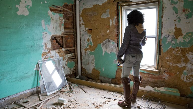 Nymiura Lee stands on the third floor of her grandparents' home in North Philadelphia. The conditions in the home became too dangerous for the family to stay.  (Lindsay Lazarski/WHYY)