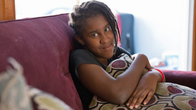 Christina Lee, a 7th grader at Feltonville School of Arts and Science, dreams of becoming a fashion designer and likes to design tattoos in her sketch book. Lee's mother says the school is not meeting her daughter's IEP. (Lindsay Lazarski/WHYY)