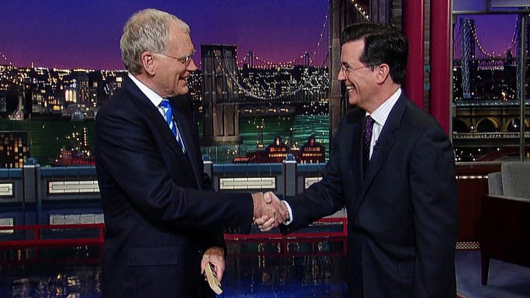 This May 4, 2011, image from video shows host David Letterman, left, shaking hands with fellow talk show host Stephen Colbert of