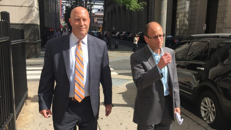 Harry Levant (right) leaves court with his defense attorney Trevan Borum. (Bobby Allyn/WHYY)