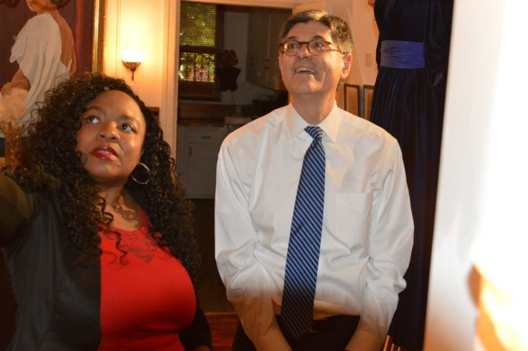 Jillian Patricia Pirtle and U.S. Treasury Secretary Jack Lew look at the dresses on display at Marian Anderson house. (Tom MacDonald/WHYY)