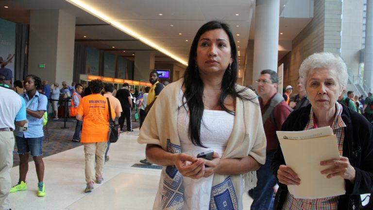 Nicole Santamaria (left), an intersex woman who traveled from El Salvador to attend the World Meeting of Families, and Sister Jeannine Gramick of Equally Blessed prepare to check in at the Pennsylvania Convention Center. (Emma Lee/WHYY)
