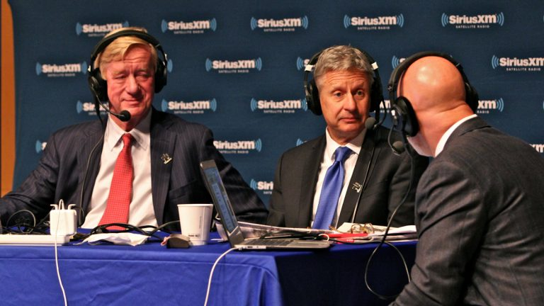 Libertarian presidential candidate Gary Johnson (center) and his running mate William Weld (left) speak with Sirius XM radio host Michael Smerconish during a forum at the National Constitution Center. (Emma Lee/WHYY)