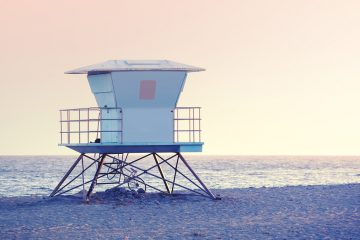 (<a href='http://www.bigstockphoto.com/image-128576894/stock-photo-rose-quartz-and-serenity-color-toned-picture-of-a-lifeguard-tower'>Big Stock</a>)