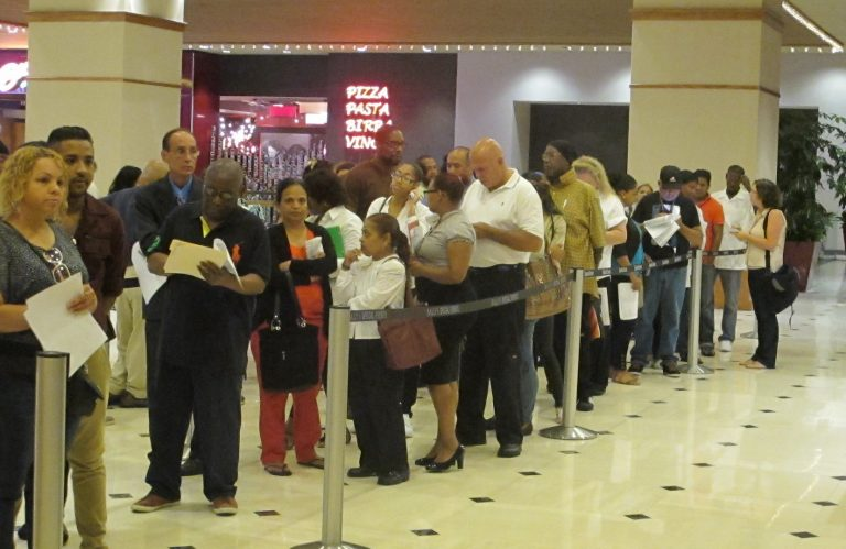 Applicants line up Wednesday at a job fair  in Atlantic City. Caesars International held the event at Bally's as it tries to fill more than 500 positions at its casinos in Atlantic City