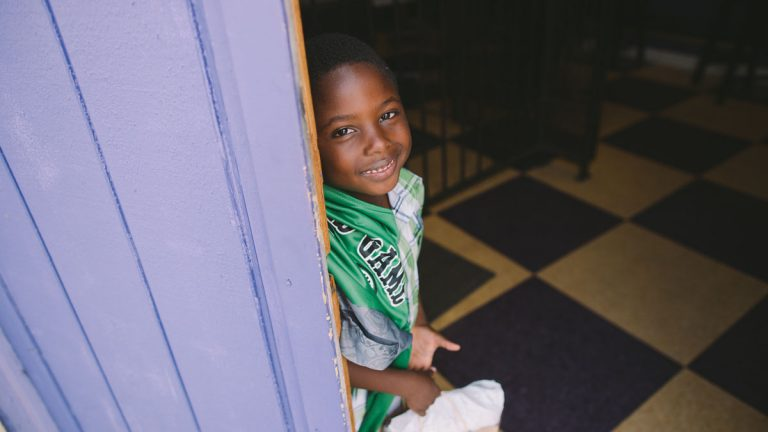 Many people in the African American community go to church as an outlet for any mental illness. Here, a young boy attends New Revelations Church in Oakland. (Alyssa Kapnik Samuel)
