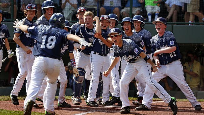 Lewisberry, Pa.'s Dylan Rodenhaber (18) runs home to a celebration with teammates after hitting a grand slam off Japan's Masafuji Nishijima in the first inning of the Little League World Series Championship baseball game in South Williamsport, Pa., Sunday, Aug. 30, 2015. (AP Photo/Gene J. Puskar)