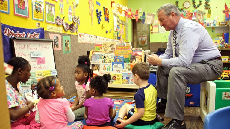 Philadelphia Mayor Jim Kenney sits in on a preschool class at Little Learners Literacy Academy in South Philadelphia. (Emma Lee/WHYY)