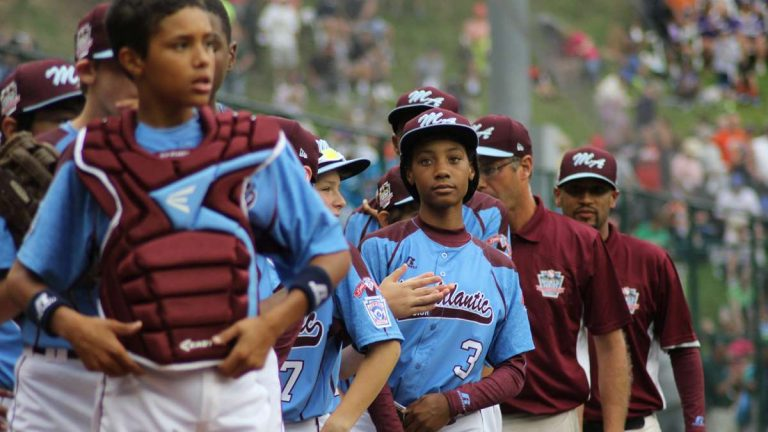 The Taney Dragons celebrate a 4-0 win at the Little League World Series in Williamsport, Pa., August 2014. (Kimberly Paynter/WHYY)