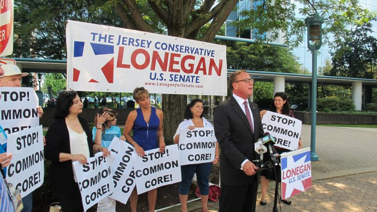 N.J. Republican U.S. Senate candidate Steve Lonegan discusses his opposition to the common core standards outside the New Jersey Education Department building in Trenton. (Phil Gregory/for NewsWorks)