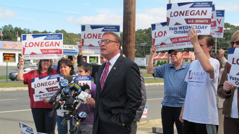 Republican U.S. Senate candidate Steve Lonegan talks with supporters at Ocean County in Toms River, New Jersey. (Phil Gregory/WHYY)