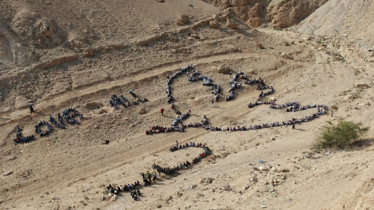 Hundreds of Palestinian children joined a United Nations Relief and Works Agency activity to send out a message of peace by lining up in the shape of a dove and the words