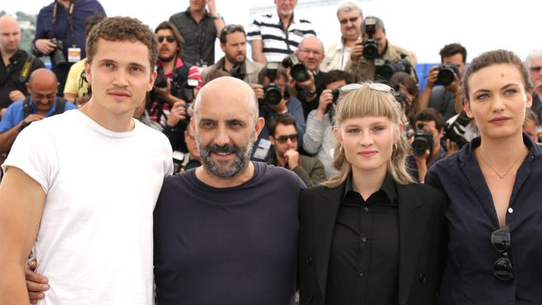 Karl Glusman, director Gaspar Noe, Klara Kristin and Aomi Muyock, pose for photographers during a photo call for the film 'Love,' at the 68th international Cannes Film Festival. (AP Photo/Lionel Cironneau)