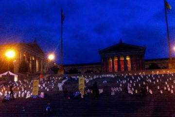 A walk to prevent suicide ends with a candlelight ceremony on the Art Museum steps. (Maiken Scott/WHYY)