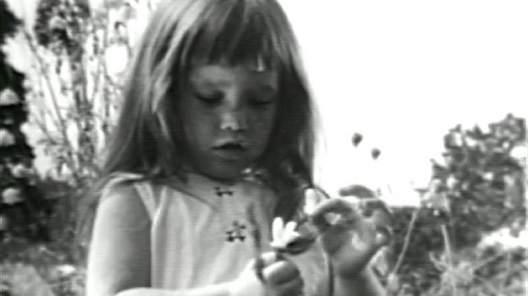 This image made from video made available by the Democratic National Committee via the LBJ Library shows a girl plucking petals from a flower in a 1964 presidential campaign television commercial titled