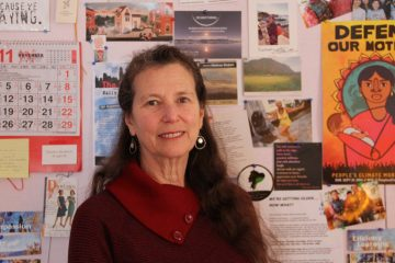 Elder-activist Lynne Iser has papered a wall of her home office in Mt. Airy with mementos of the many causes she has supported. (Emma Lee/WHYY)