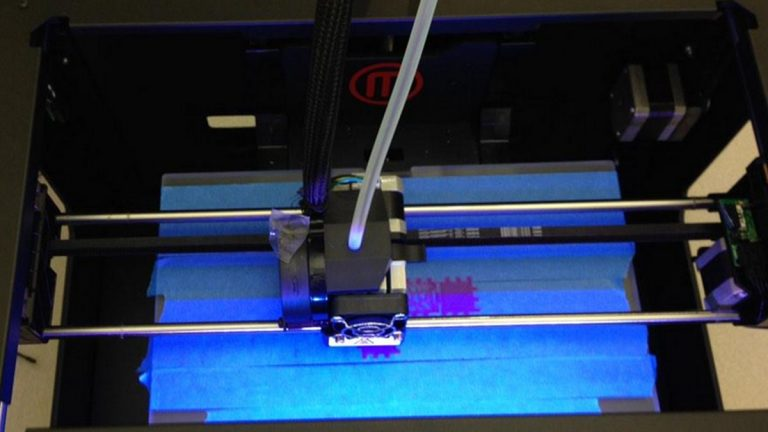 A Makerbot Replicator 3D printer in action at the library in Wilmington. (Mark Eichmann/WHYY)