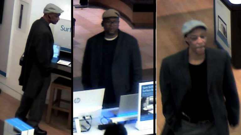 Surveillance photos show two men Delaware State Police say stole laptops from the Microsoft store in the Christiana Mall. (photo courtesy Delaware State Police)