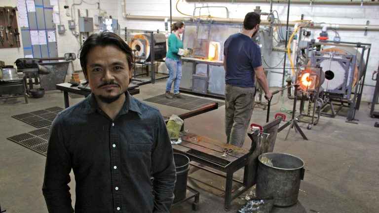 John Pomp  says moving his studio to Philadelphia led to the rapid growth of his custom glass manufacturing business. (Emma Lee/WHYY)
