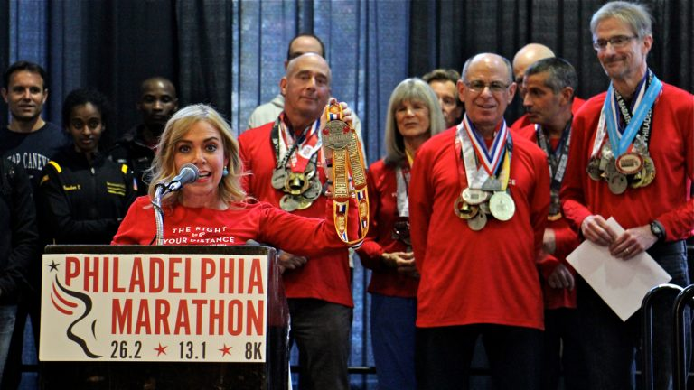 Philadelphia Marathon Executive Director Sheila Hess holds up a medal that will be awarded to finishers of the Rocky Challenge