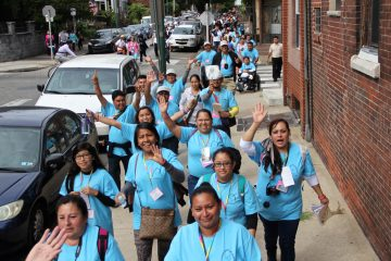 About 1,000 people march through South Philadelphia to Independence Mall to hear Pope Francis speak. (Emma Lee/WHYY)