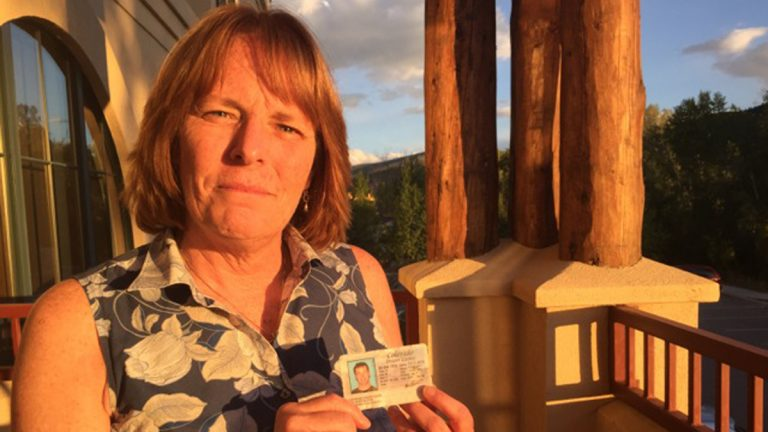 Aspen resident Kim Baillargeon holding her son Raymond Vieira's driver's license. He committed suicide in 2014. (Marci Krivonen/for The Pulse)