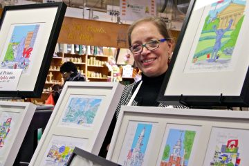 Marilyn MacGregor sells her prints from a wagon in Reading Terminal Market. (Emma Lee/WHYY)