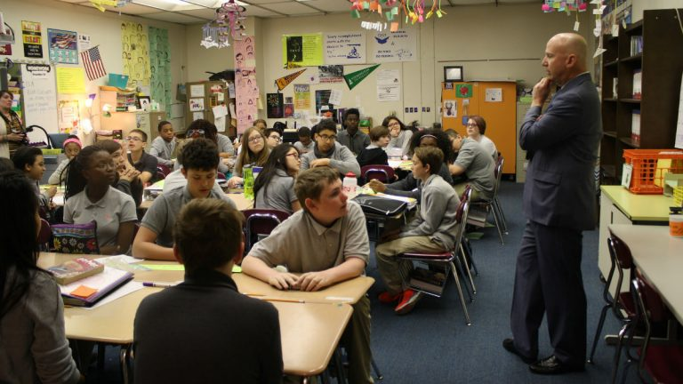 Delaware Gov. Jack Markell talks with students at Gauger-Cobbs Middle School. (photo courtesy Markell admin./Flickr)