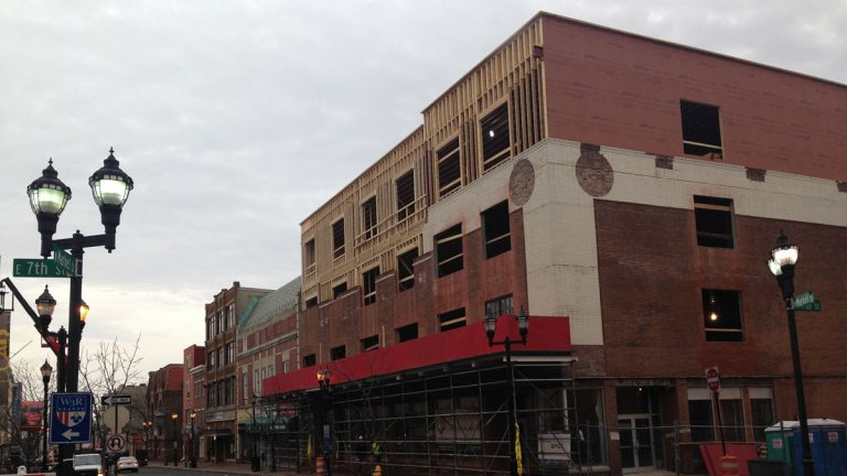 Work is progressing on this residential/retail building on Market St. in Wilmington. (Mark Eichmann/WHYY)