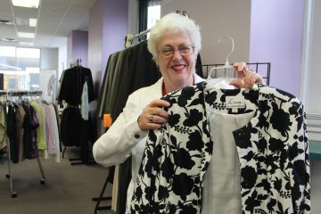 Mary Campbell volunteers at Career Wardrobe in Center City, where she volunteers to help low income individuals get the professional attire they need to secure and maintain employment opportunities and career advancement.  (Emma Lee/WHYY)